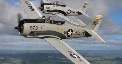 Two US Navy Trojan Aircraft Grey in Colour.